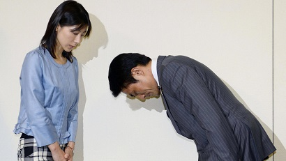 Akihiro Suzuki, Ayaka Shiomura...Tokyo city assemblyman Akihiro Suzuki bows to his female counterpart Ayaka Shiomura for an apology at Tokyo Metropolitan City Hall in Tokyo Monday, June 23, 2014. Suzuki from Prime Minister Shinzo Abe s ruling party apologized for throwing one of several sexist hecklings at Shiomura Monday, five days after officials scrambled to identify the voices heard during her speech. A voice from the floor said  You are the one who should get married first,  followed by laughter and more hecklings including  She must be single  and  Can t you have babies?  as Shiomura asked Tokyo s maternity support measures.  (AP Photo/Kyodo News) JAPAN OUT, CREDIT MANDATORY